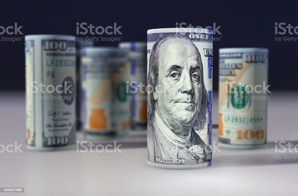US dollars. Banknotes stacked on each other stock photo
