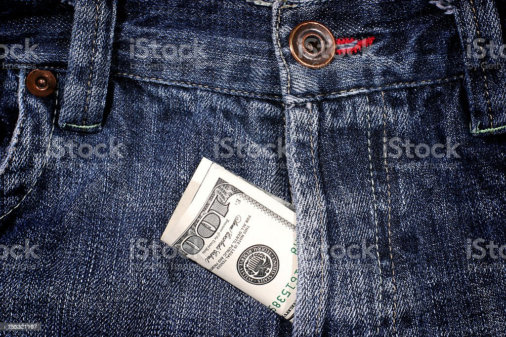 dollars bill in blue jeans fly stock photo