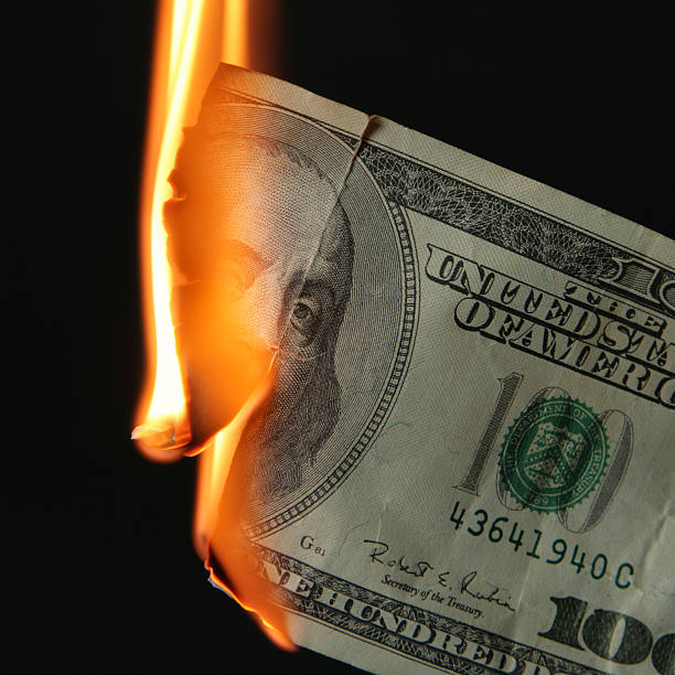 dollars burn - money black background stock photos and pictures