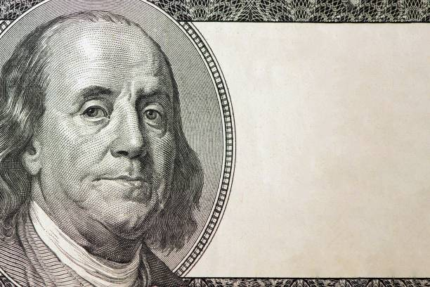 Dollars closeup. Benjamin Franklin's portrait on one hundred dollar bill with copy space Dollars closeup. Benjamin Franklin's portrait on one hundred dollar bill with copy space. benjamin franklin stock pictures, royalty-free photos & images