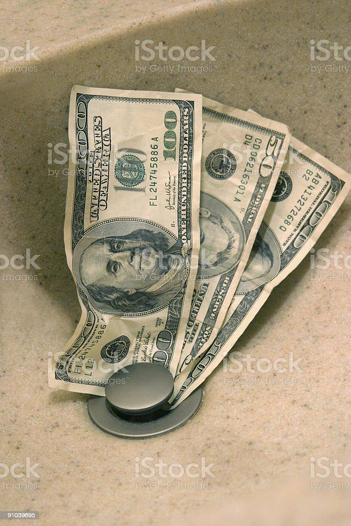 Dollars Down the Drain 1 stock photo