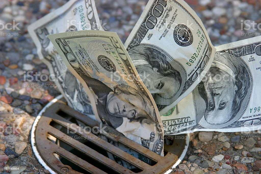 Dollars Down the Drain stock photo
