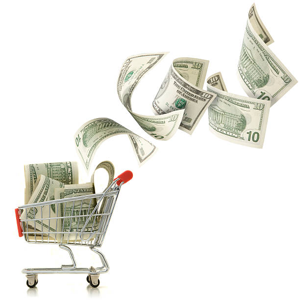 Dollar fallen in einen Einkaufswagen – Foto