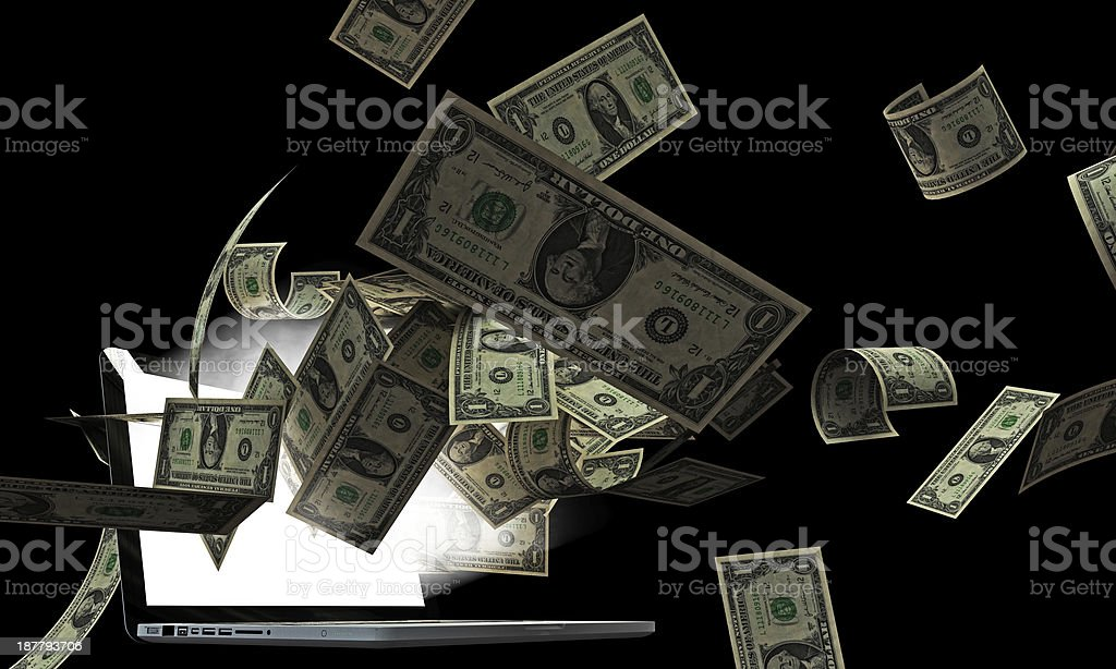 dollars from laptop royalty-free stock photo