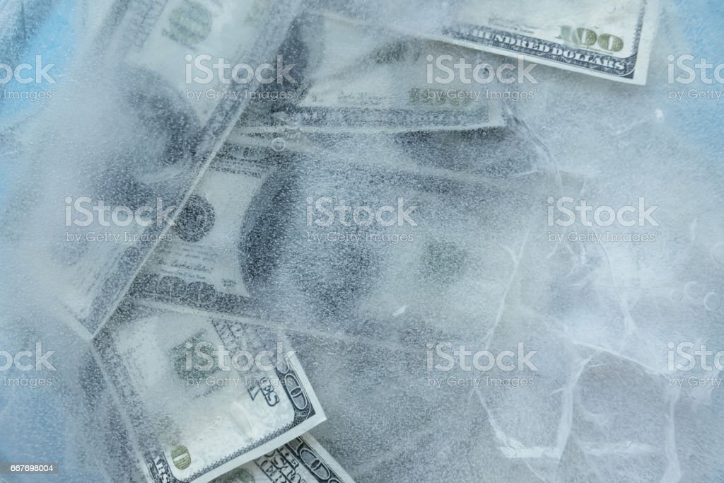 100 dollars frozen melt. stock photo