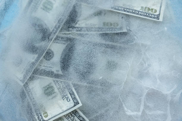 100 dollars frozen melt. - frozen stock pictures, royalty-free photos & images