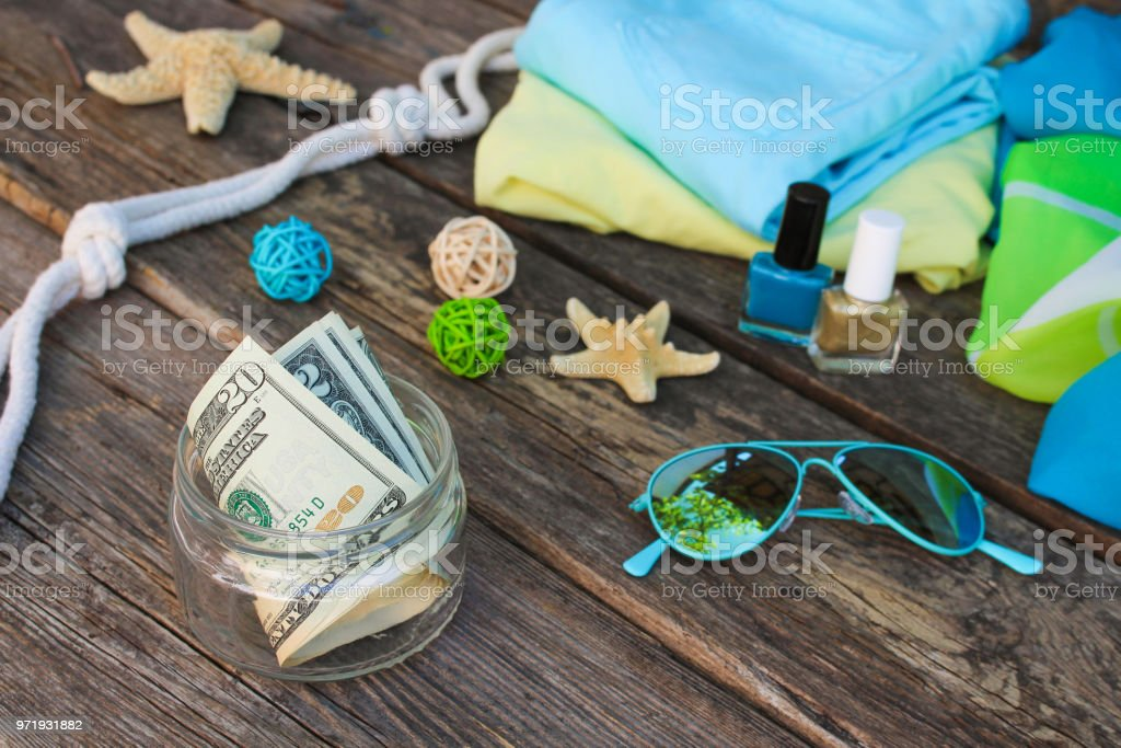 dollars in glass jar concept of collecting money for journey toned