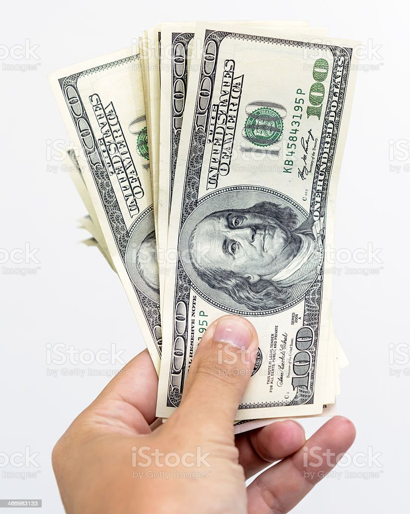 dollars in his hand royalty-free stock photo