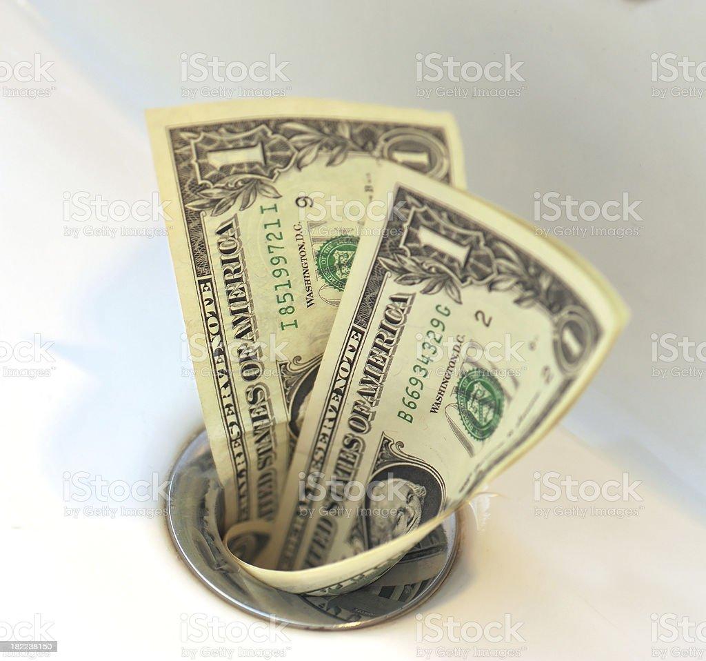 dollars in sink stock photo