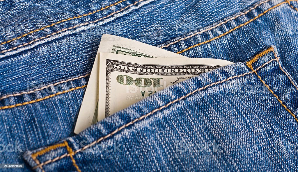 Dollars in the jeans stock photo