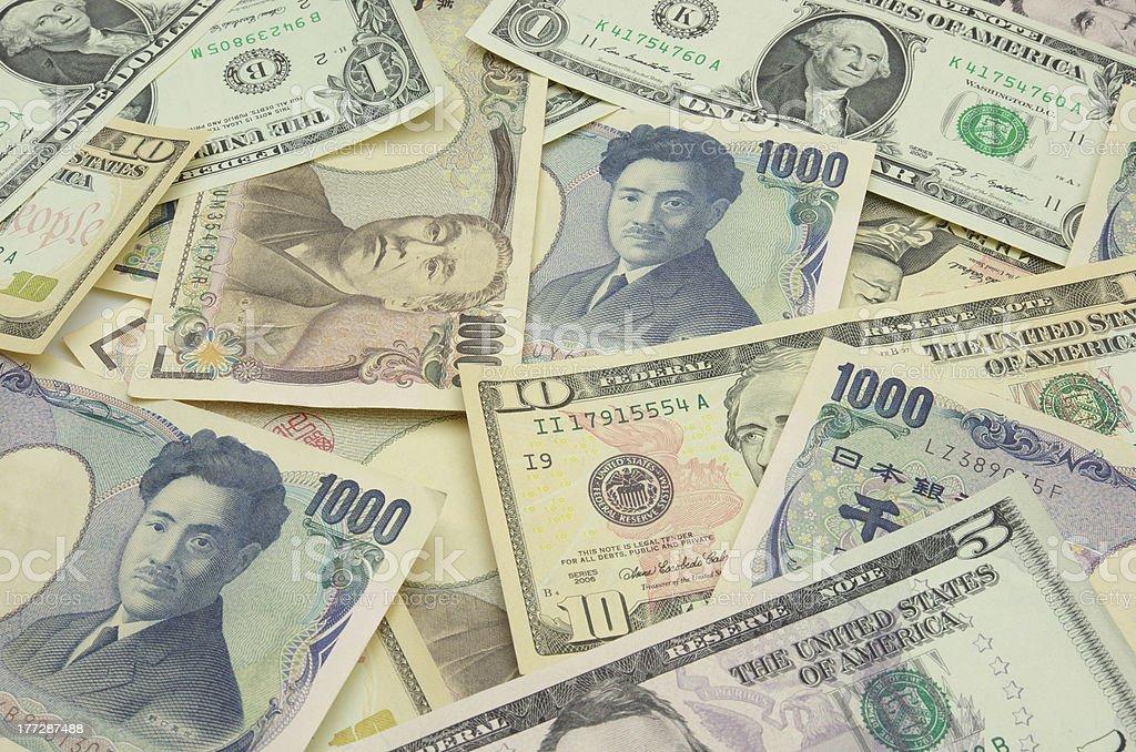US Dollars, Japanese Yen bills stock photo