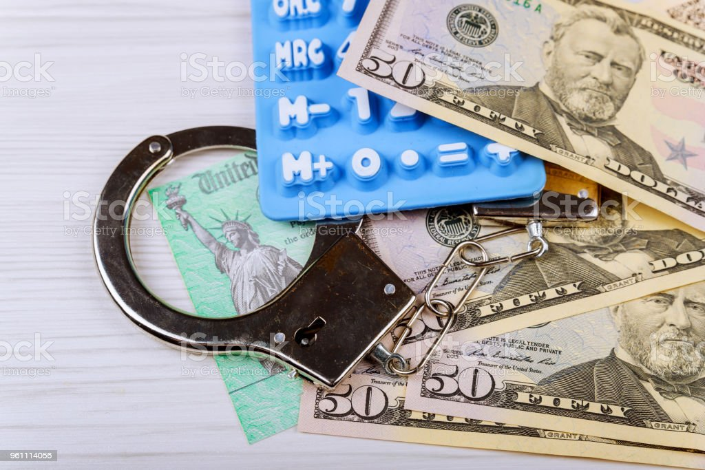 Dollars Money And Handcuffs On Wood Texture Background Crime