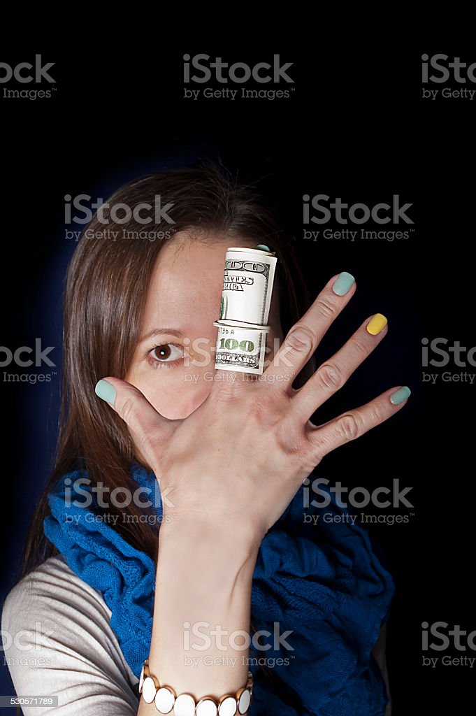 Dollars on a Forefinger stock photo