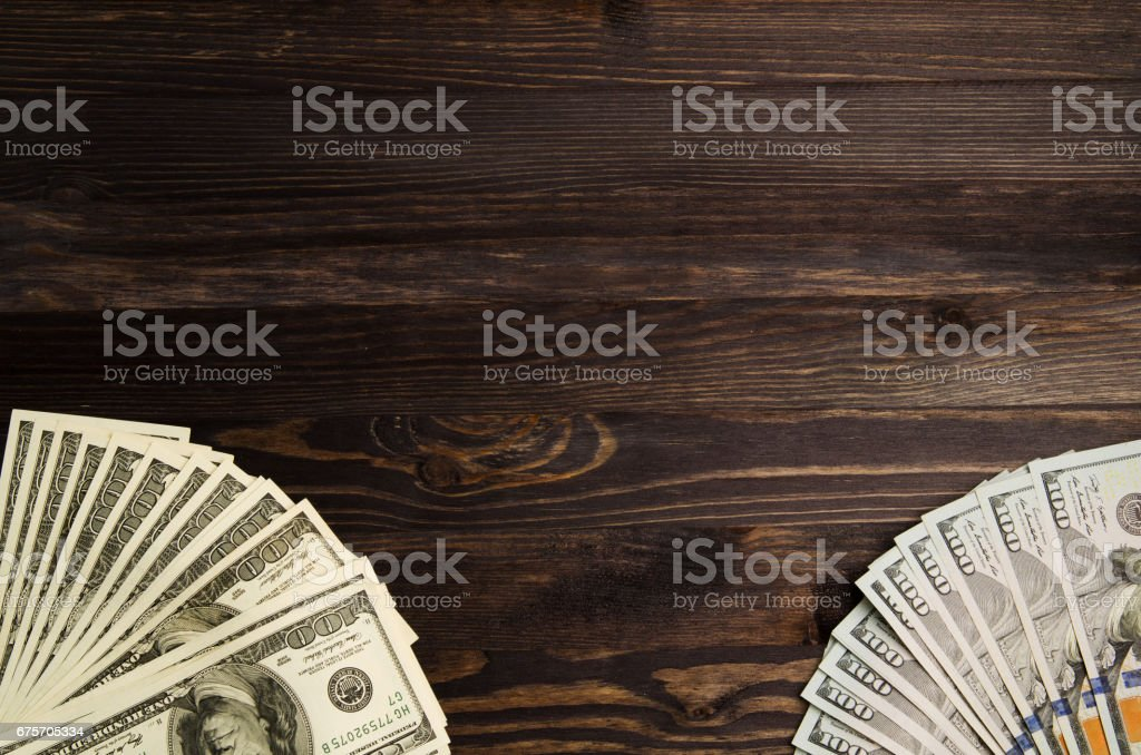 Dollars on a wooden background. dollar top view 免版稅 stock photo