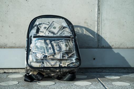 Backpack full of US dollars