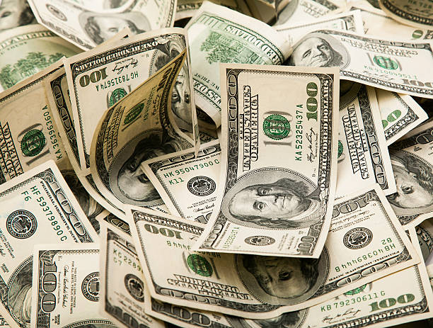 Dollars Cash money background. millionnaire stock pictures, royalty-free photos & images