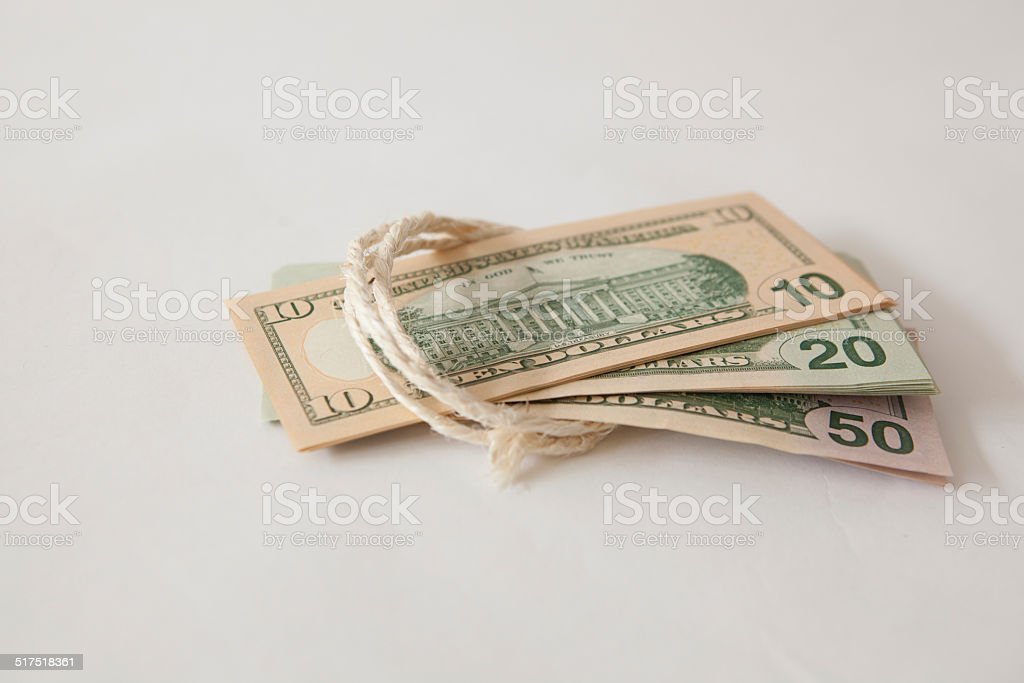 dollars tied up with string stock photo