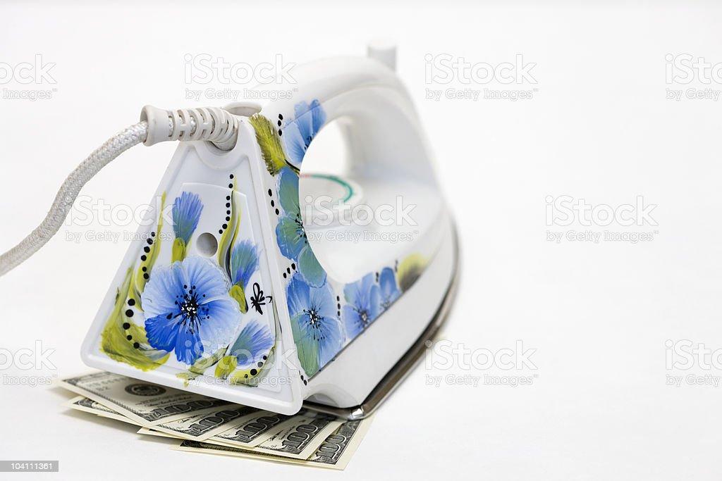 Dollars USA and Smoothing-iron stock photo