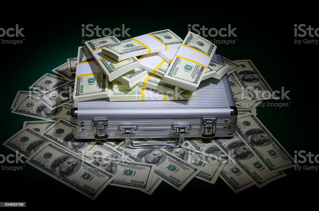Dollars with metallic case stock photo
