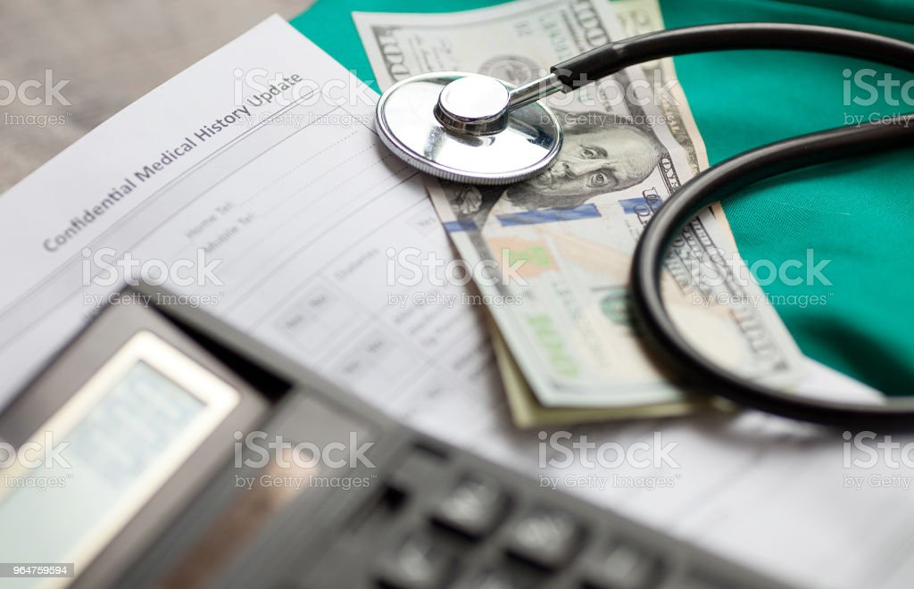 Dollars with stethoscope on them royalty-free stock photo