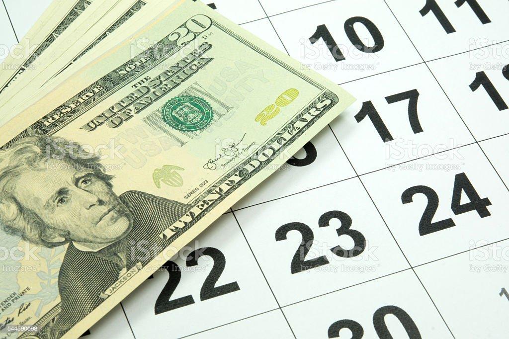 Dollarscheine auf einem Kalender – Foto