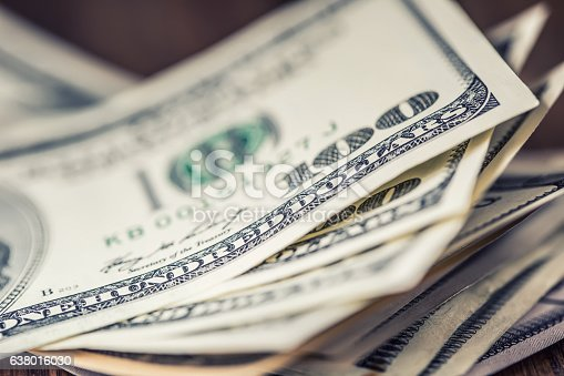 istock Dollars.Close-up view of stack of US dollars. Cash American Dollars. 638016030