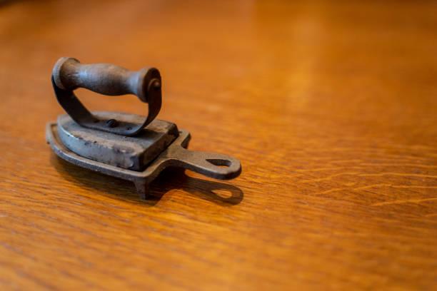 Dollhouse iron from World War II stock photo