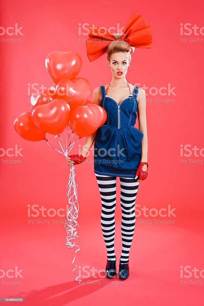 Doll-like woman with red balloons royalty-free stock photo
