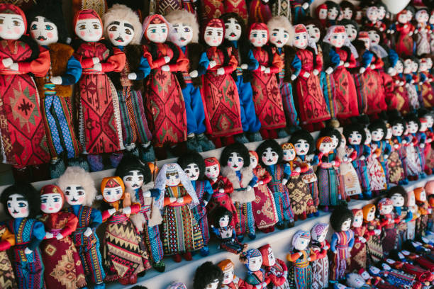 Dolls in Armenian national costumes. Flea market Vernissage Yerevan, Armenia Dolls in Armenian national costumes. Flea market Vernissage Yerevan, Armenia armenia country stock pictures, royalty-free photos & images