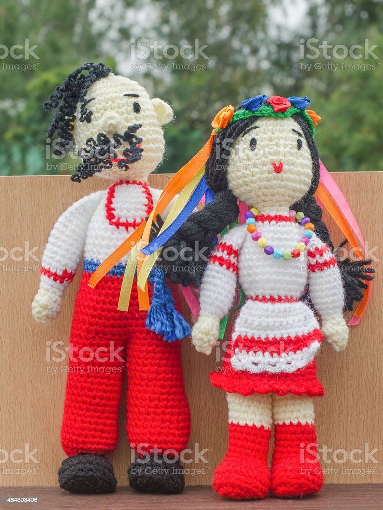 Dolls. Knitted toys and souvenirs stock photo