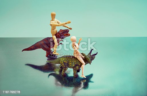 Plastic dinosaurs and dolls, wooden dolls,