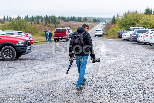 istock Dolly Sods Bear Rocks trail with parking lot and cars parked in West Virginia fall season and photographer people hiking man with tripod camera and backpack 1322534141