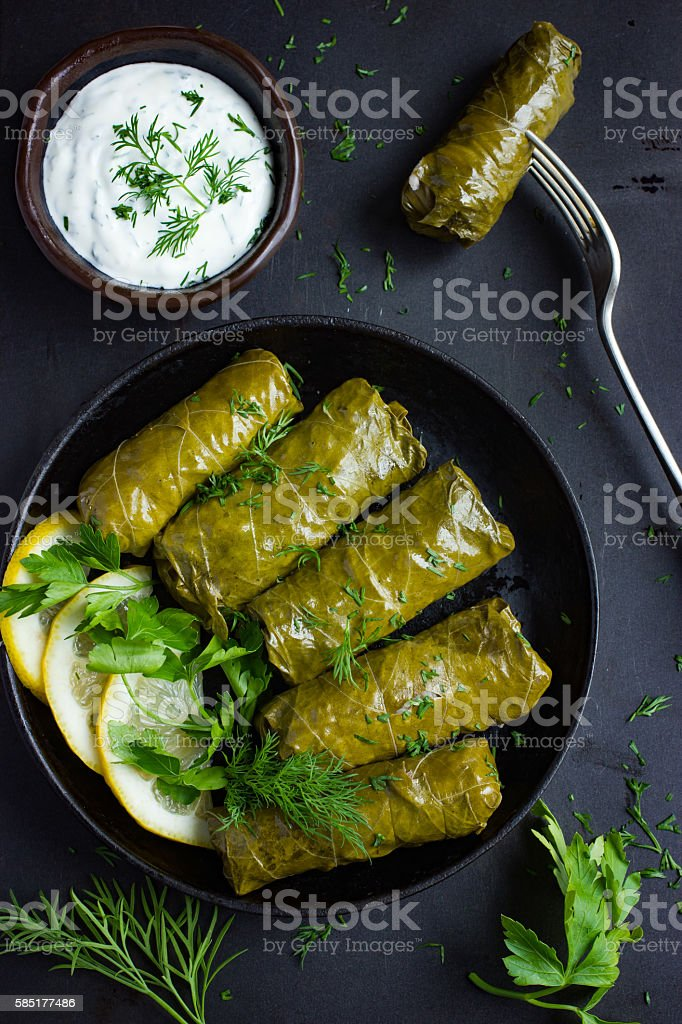 Dolma, stuffed grape leaves with rice and meat stock photo