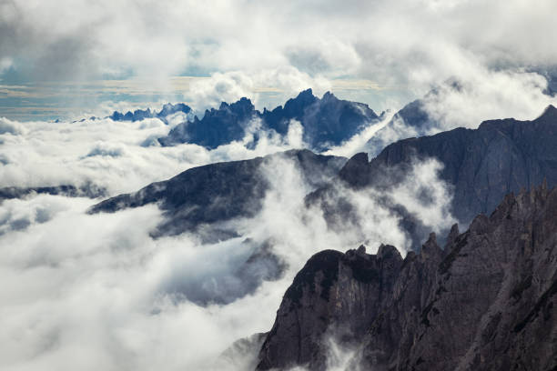 Dolomite alps covered with low clouds in Tre Cime di Lavaredo national park stock photo