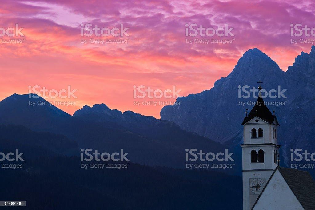 Dolomites Church Colle Santa Lucia at sunrise, Alps, Italy stock photo