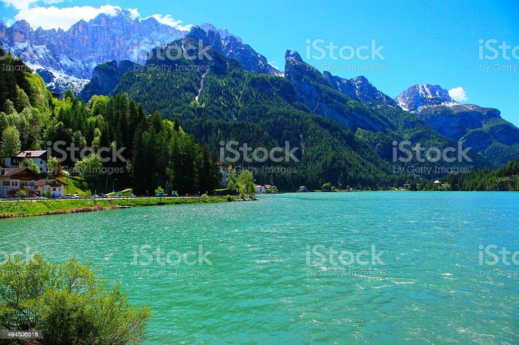 Dolomites italian alpine green Alleghe village, turquoise lake, Mount Civetta stock photo