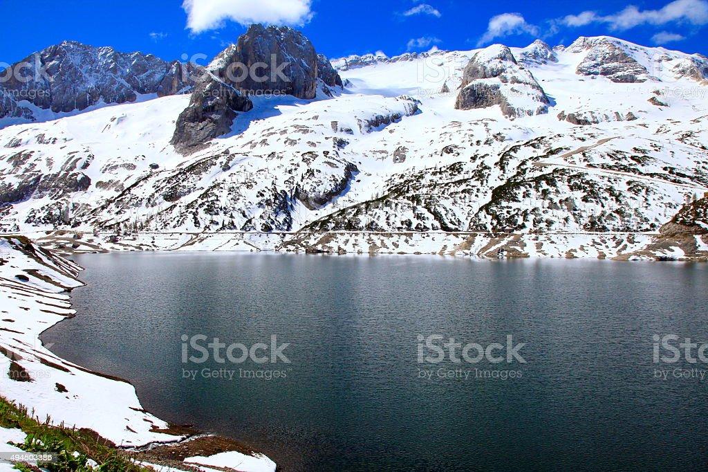 Dolomites italian alpine paradise: Civetta, Marmolada Glacier, Fedaia Pass lake stock photo