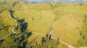 Dolomites, Italy. Aerial drone landscape of the meadows at high altitudes, forming soft hills