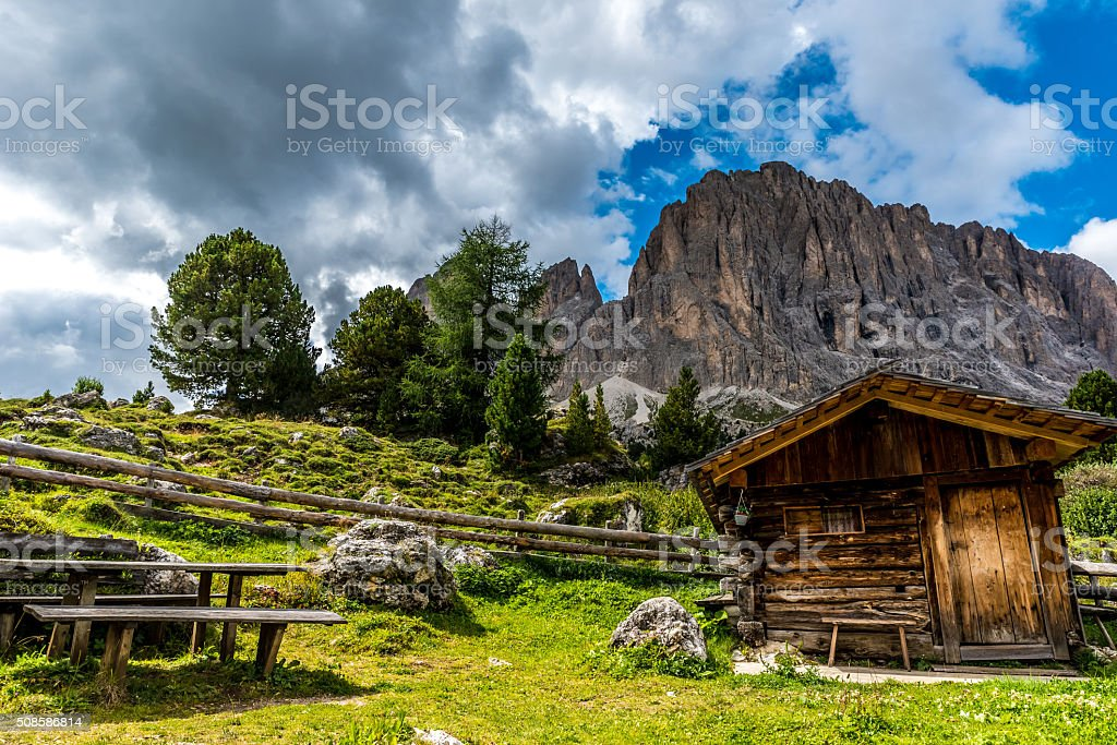 Dolomites Italy - beautiful wooden house in mountains stock photo