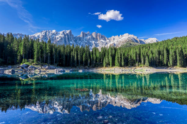 dolomites - lake carezza - karersee, trentino-alto adige, italy - saturated color stock pictures, royalty-free photos & images