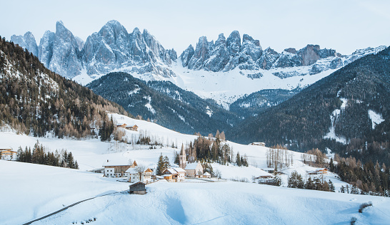 Dolomites mountain peaks with Val di Funes village in winter, South Tyrol, Italy