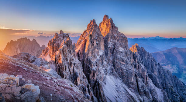Dolomites mountains  glowing at sunset, South Tyrol, Italy Panoramic view of famous Dolomites mountain peaks glowing in beautiful golden evening light at sunset in summer, South Tyrol, Italy dolomites stock pictures, royalty-free photos & images