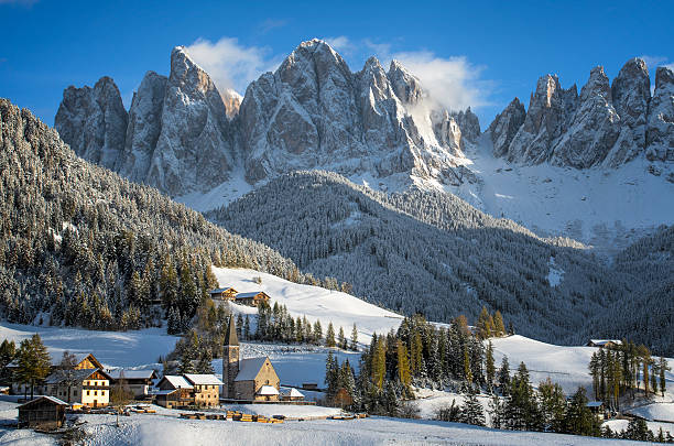 Dolomites village in winter The small village of St. Magdalena or Santa Maddalena with its church covered in snow and with the Odle or Geisler Dolomites mountains behind it in the Val di Funes Valley (Villnösstal) in South Tyrol in Italy in winter. dolomites stock pictures, royalty-free photos & images