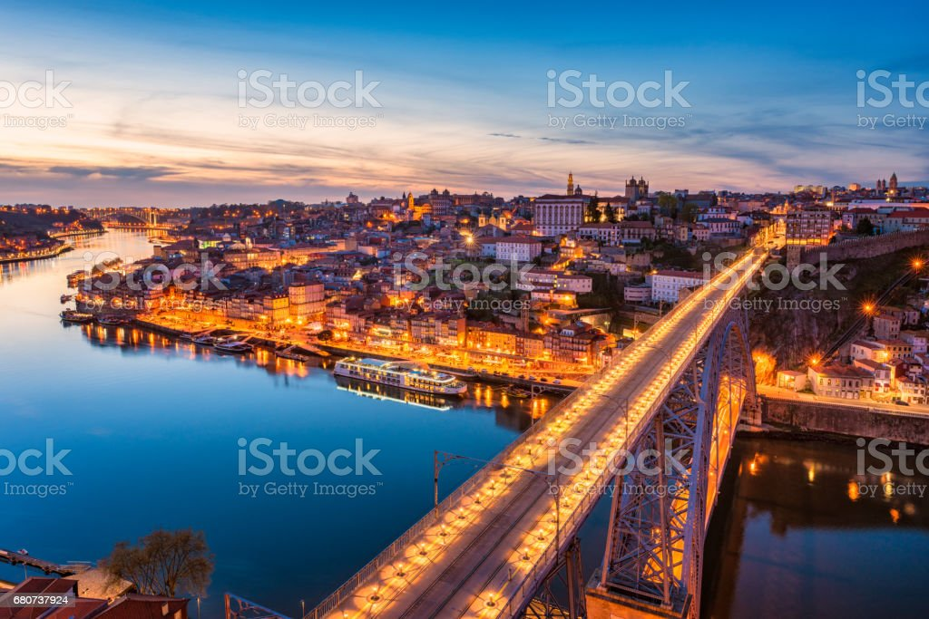 Dom Luis I Bridge and Skyline of Porto Portugal at Dusk stock photo