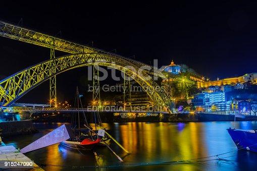 PORTO, PORTUGAL - DECEMBER 23, 2017: Night view of the Dom Luis I Bridge and the Douro river, in Porto, Portugal