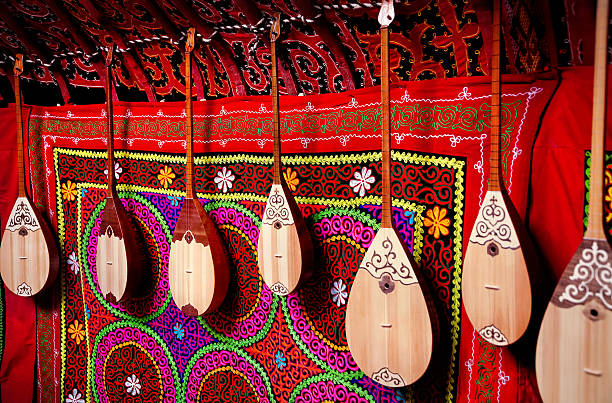Dombra instrument in Kazakh yurt interior Dombra string instruments on the wall of Kazakh yurt at Nauryz celebration in Almaty, Kazakhstan kazakhstan stock pictures, royalty-free photos & images