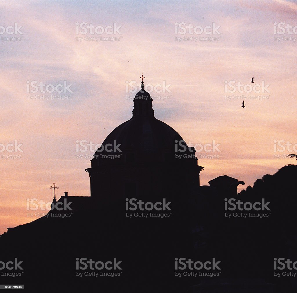 Dome at Piazza Venezia under sunset in Rome royalty-free stock photo