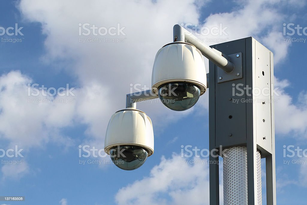 Dome CCTV camera against the blue sky royalty-free stock photo