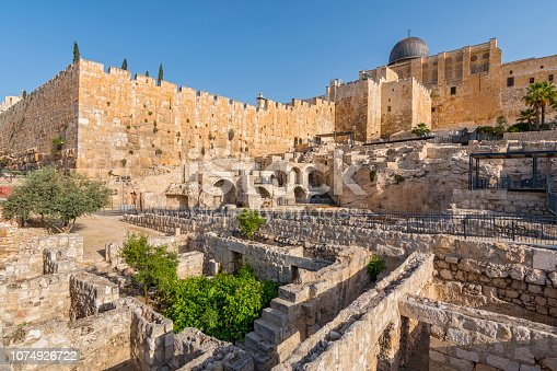Dome of Al Aqsa Mosque surrounded by walls and ancient ruins in Old City of Jerusalem, Israel.
