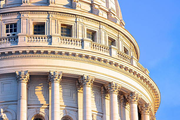Dome of Capitol building partial view A partial view of the Wisconsin State Capitol dome in Madison.  wisconsin state capitol stock pictures, royalty-free photos & images
